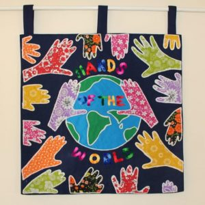 hands around the world wall hanging